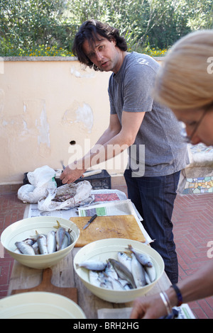 ©John Angerson Gabriel David prepares pasta con le sarde. - Stock Photo