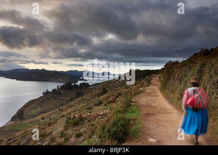 a woman on the Isla del Sol at dawn, Lake Titicaca, Bolivia - Stock Photo