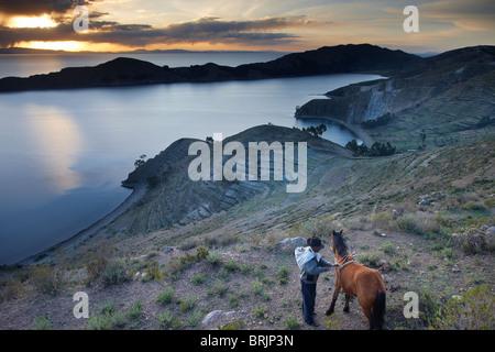a campesino with his horse on Isla del Sol, Lake Titicaca, Bolivia - Stock Photo