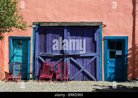 Colorful buildings in Madrid, NM, along the Turquoise Trail. - Stock Photo