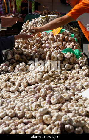 Stock photo of Garlic for sale on a French market stall. - Stock Photo