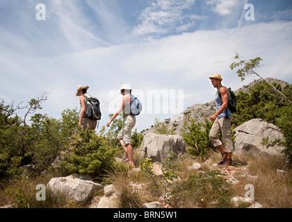 Hikers on coastal path - Stock Photo