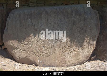 Megalithic stone surrounding main mound, Knowth neolithic passage grave, Boyne Valley, Ireland - Stock Photo