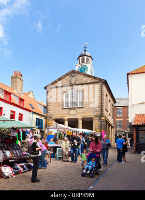 Street market stalls in the old town square Whitby, North Yorkshire, England, UK - Stock Photo