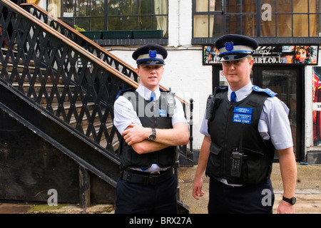 Camden Town Market Lock , two young Community Support Officers pose in uniform while on patrol in market - Stock Photo