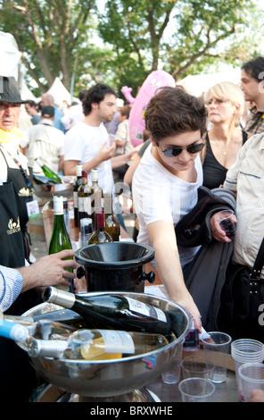 people tasting wine at a stand in Paris, 'Fete des Vendanges' , harvest fest - Stock Photo