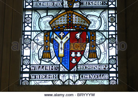 Winchester UK - Stained glass windows of famous historical figures in the Great Hall. Shield of William Wareham - Stock Photo