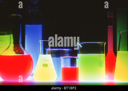 group of dayglo laboratory beakers - Stock Photo