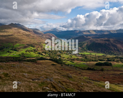 The village of Beddgelert in Nantgwynant, Snowdonia viewed from the slopes of Moel Hebog. Moel Siabod and Llyn Dinas - Stock Photo