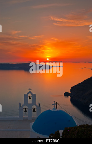 Church Dome and Bell Tower Firostefani Santorini Cyclades Islands Greece at sunset - Stock Photo