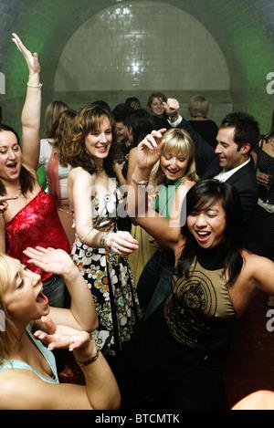 Young people dancing in a London nightclub - Stock Photo
