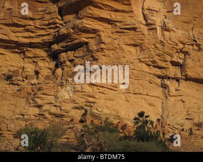 Cliff dwellings along the base of the Bandiagara escarpments - Stock Photo