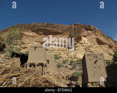 Cliff dwellings along the base of the Bandiagara escarpment - Stock Photo
