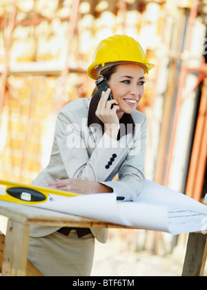 female architect in construction site - Stock Photo