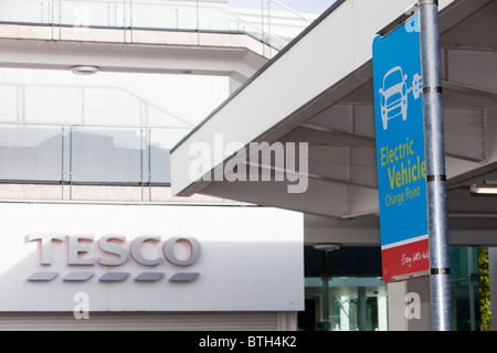 An electric car charging point provided free of charge in a Tesco Supermarket car park for their customers, London. - Stock Photo