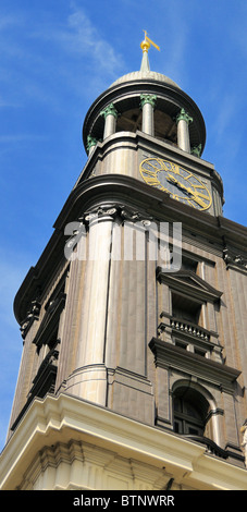 The 132 m-high baroque spire, covered with copper, is a prominent feature of the St. Michaelis Church in Hamburg, - Stock Photo