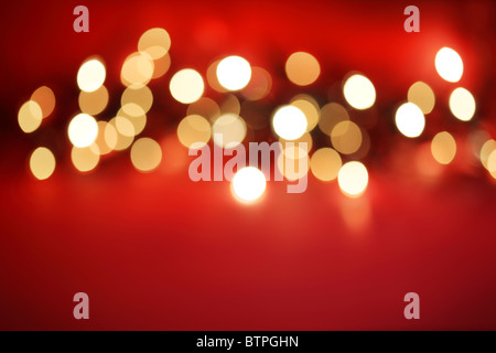 Defocussed lights on red - Stock Photo