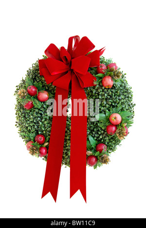 Christmas wreath with red velvet bow isolated on a white background - Stock Photo