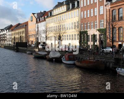 Raw of appartments and canal - Overgaden Neden Vandet - Christianhavn - Copenhagen - Denmark - Stock Photo