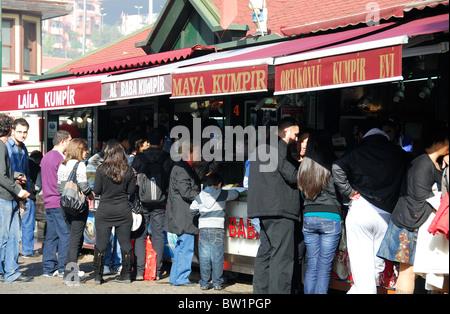 ISTANBUL, TURKEY. A row of stalls selling hot baked potatoes (kumpir) at Ortakoy market, Besiktas district. 2010. - Stock Photo