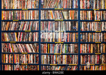 Full frame of rows of DVDs in video store or library - Stock Photo