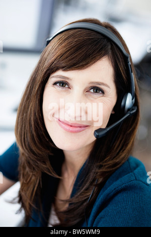 Woman with headset portrait - Stock Photo