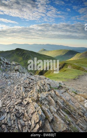 View from the summit of Hopegill Head, looking back along the footpath towards Causey Pike in the English Lake District - Stock Photo