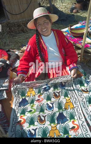 Indigenous woman selling handcrafts, Uros Island, Lake Titicaca, Peru - Stock Photo