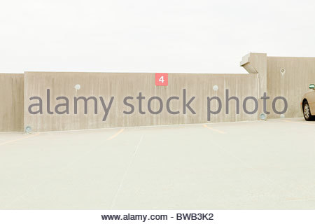 Empty car park with number 4 parking space - Stock Photo