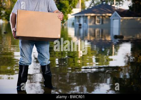 USA, Illinois, Chillicothe, Man holding cardboard box - Stock Photo