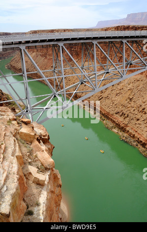 Navajo Bridge Crossing Marble Canyon with Rafters Below - Stock Photo