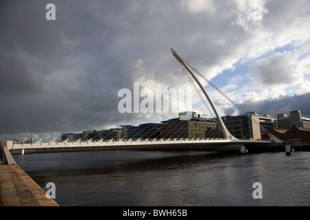 the new Samuel Beckett Bridge across the river liffey in Dublin republic of ireland under dark grey stormy skies - Stock Photo