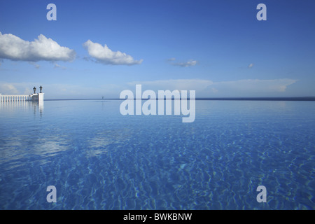 The infinity pool of a hotel under blue sky, Bohol island, Philippines, Asia - Stock Photo