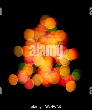 Out of focus colorful Christmas tree lights isolated on black background - Stock Photo