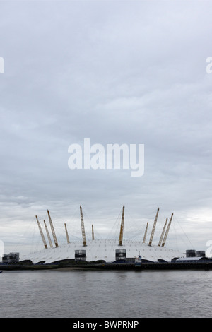 One of London`s famous landmarks,the O2 Arena ,situated on the Greenwich Peninsular,views here from the north bank - Stock Photo