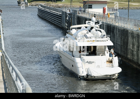 View of luxury yatch passing through Port Mayaca lock and dam exiting Lake Okeechobee, Florida into St. Lucie Canal. - Stock Photo