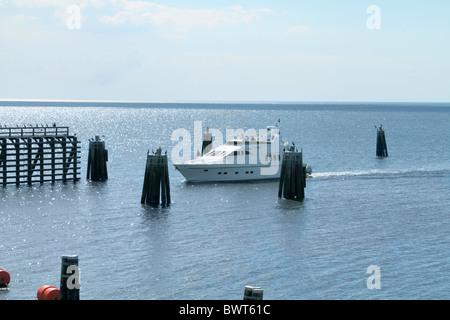 View of luxury yatch on Lake Okeechobee, approaching Port Mayaca lock and dam. Florida, USA. - Stock Photo