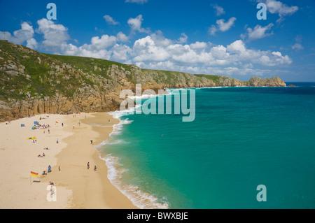 Tourists sunbathing on Porthcurno beach Cornwall England GB UK EU Europe - Stock Photo