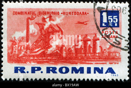 ROMANIA - CIRCA 1963: A stamp printed in Romaia shows Hunedoara metal factory, circa 1963 - Stock Photo