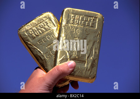500 grams gold gold bar hand money finances Credit Suisse gold Country California USA United States America - Stock Photo