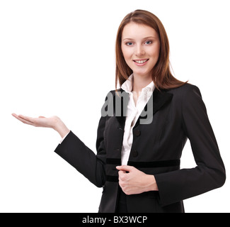 Young woman in business suit shows her empty palm. Isolated on a white background. - Stock Photo