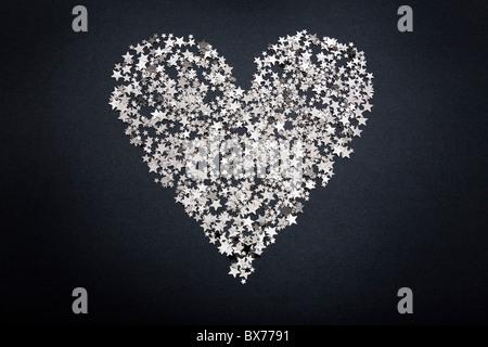 Heart shape figure made of small stars - Stock Photo