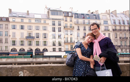 Couple embrace after shopping in Paris - Stock Photo