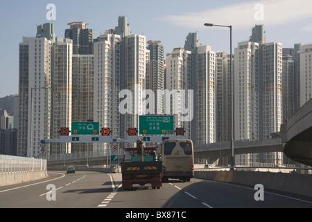 China Hong Kong approaching Kowloon along road from airport - Stock Photo