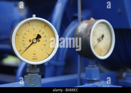 Old pressure gauge on a pump. - Stock Photo