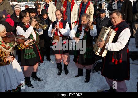 Poland Krakow Folk Musicians dressed in Traditional Polish Costume performing during Szopki crib making contest - Stock Photo