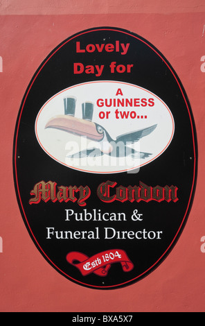 An amusing sign combination: a publican and funeral director in one. Cahir, Co Tipperary, Ireland (Eire). - Stock Photo