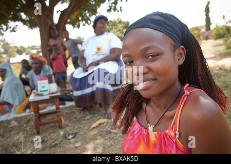 A young woman, Winny Belinda Wasagali, attends a community meeting at Bunyonjo Village - Mbale, Eastern Uganda, - Stock Photo