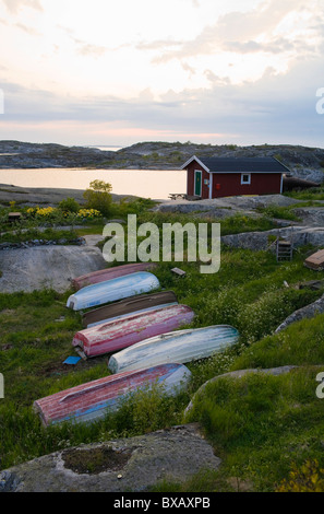 Row of old boats lying on grass - Stock Photo
