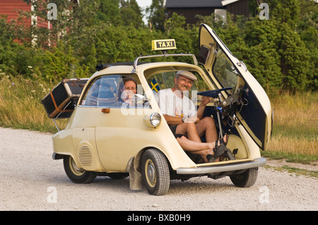 Trip in small vintage car - Stock Photo